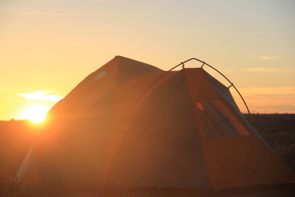 Tent in font of sunrise